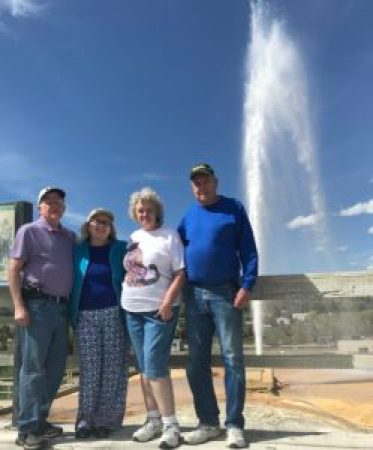 four old geysers standing in front of a geyser