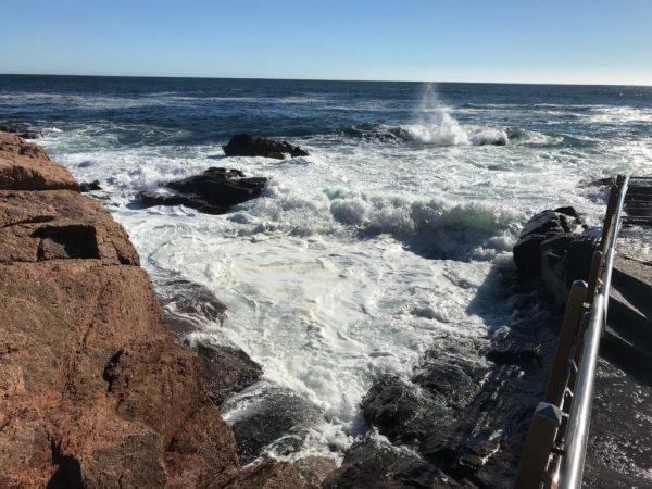 ocean breaking on huge, jagged rocks