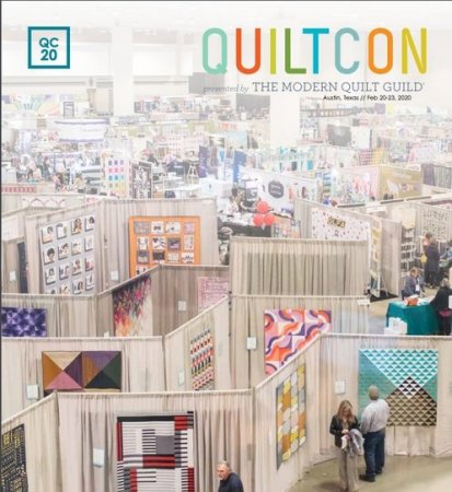 """book with quilts on the cover and the word """"Quiltcon"""" with each letter in a different color"""
