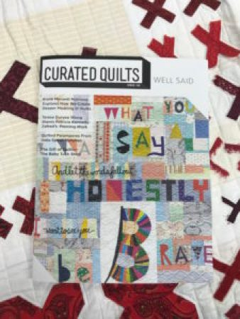 cover of Curated Quilts magazine with words sewn into quilts