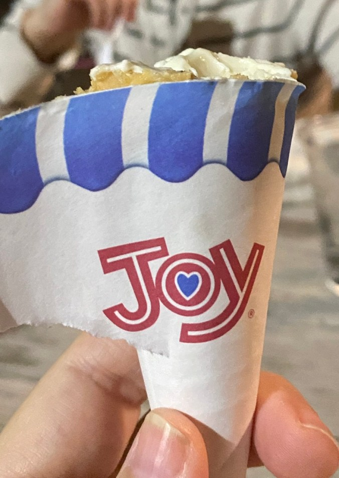 """the word """"joy"""" on an ice cream cone wrapper"""