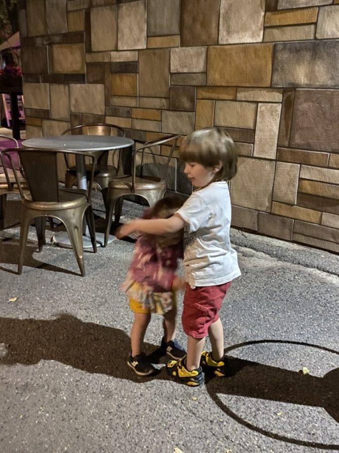 a little boy hugs a little girl