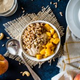 Farro Breakfast Bowl with Caramelized Peaches and Cashew Cream