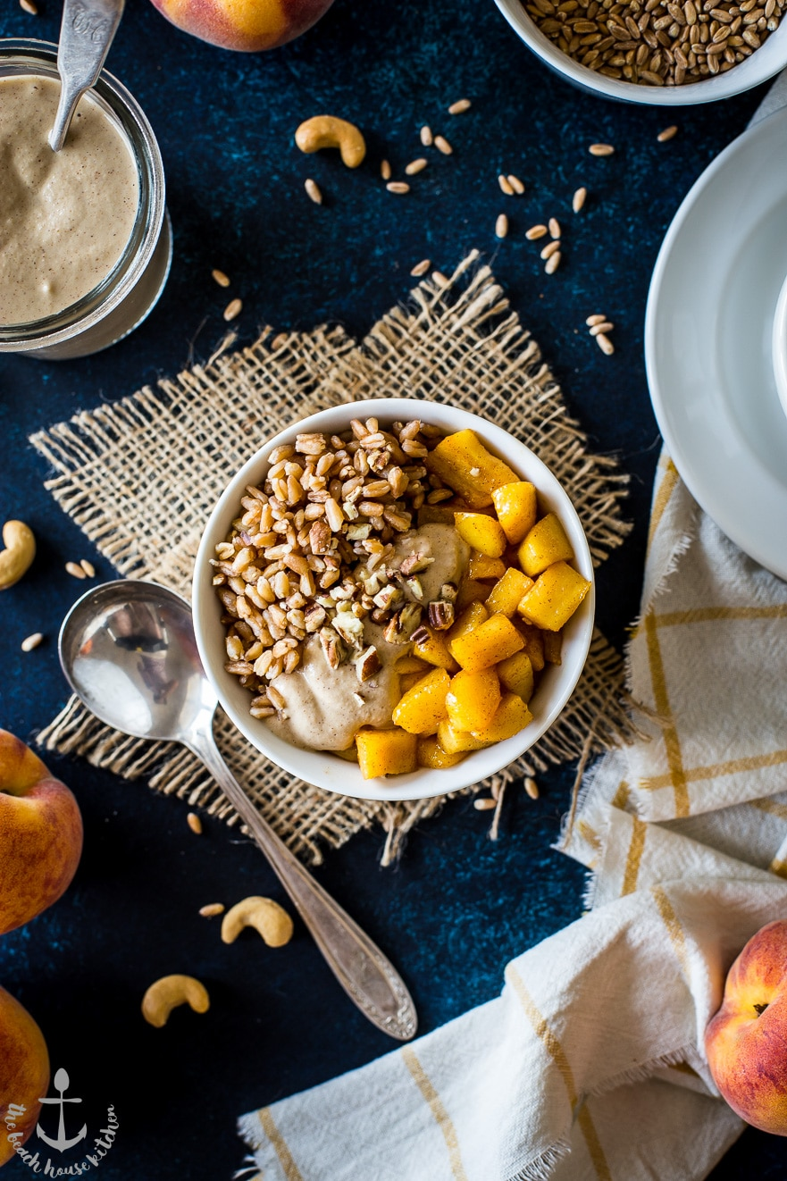 Farro Breakfast Bowl with Caramelized Peaches and Cinnamon Cashew Cream