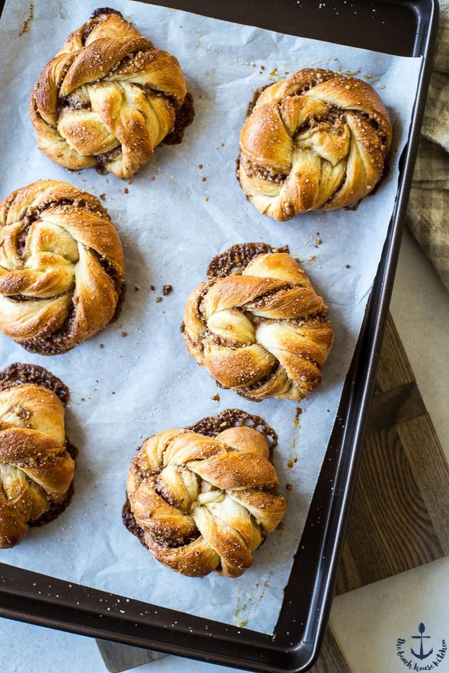 Overhead photo of Cinnamon Pecan Knots on baking sheet