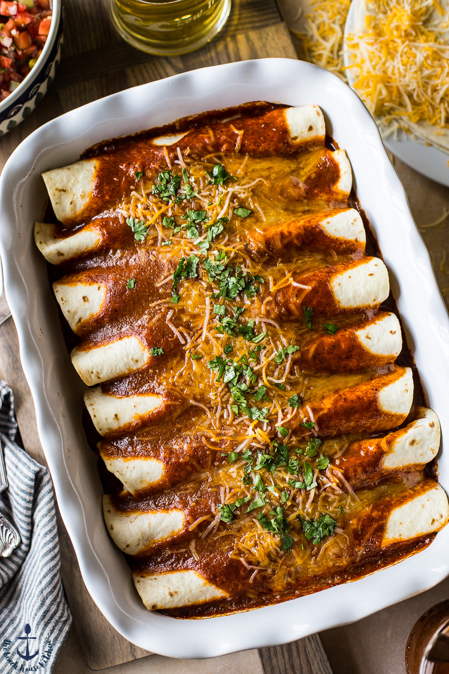 Closeup overhead photo of easy beef enchiladas in white dish