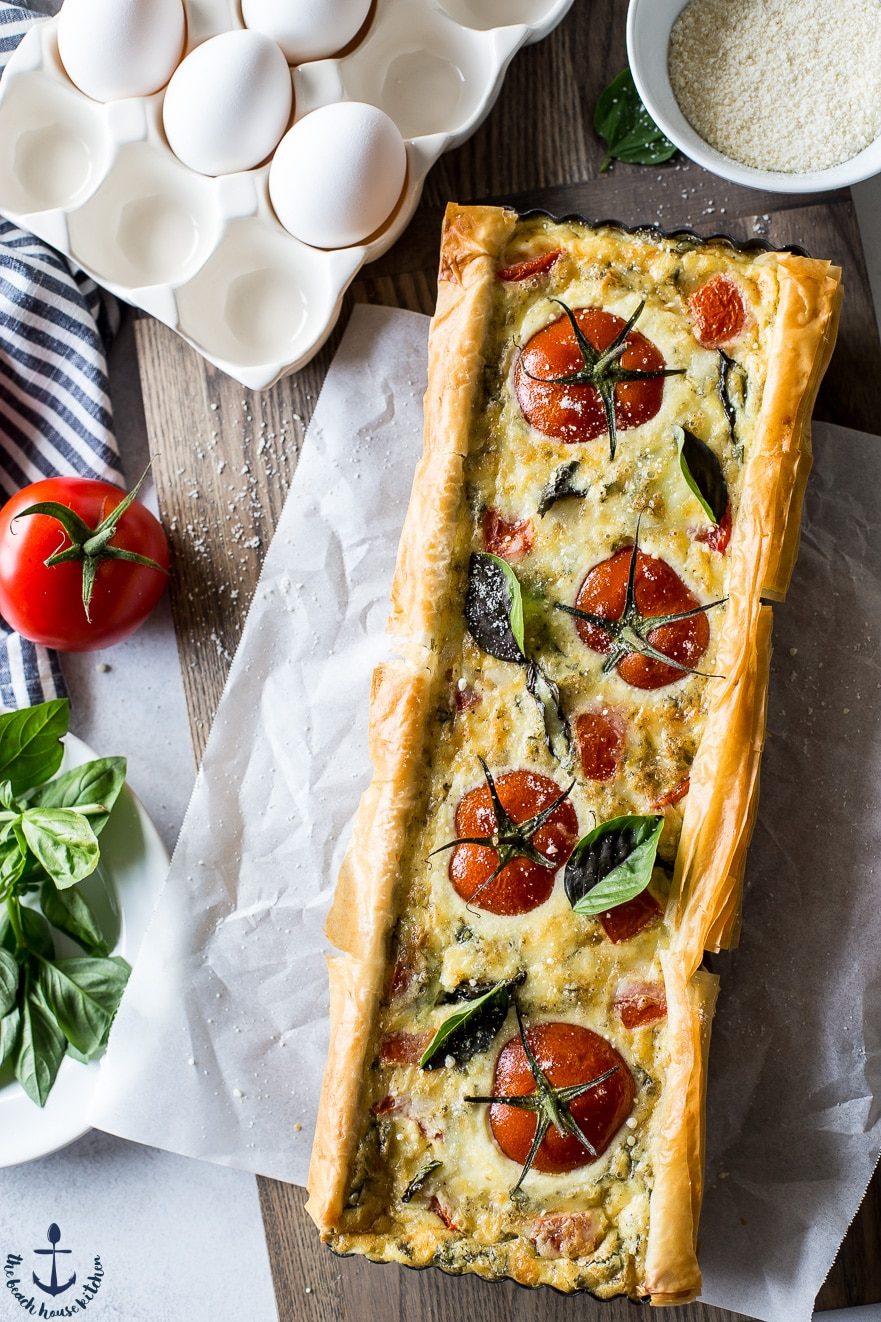 Overhead photo of tomato basil tart on parchment paper