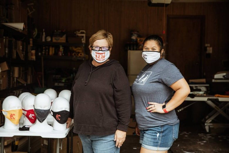 (Left to right) LeAnne Stowe and Lina McCamon of Annie's Barn, in LeAnne's garage-turned-mask-production-line. (Chase Castor/Beacon)