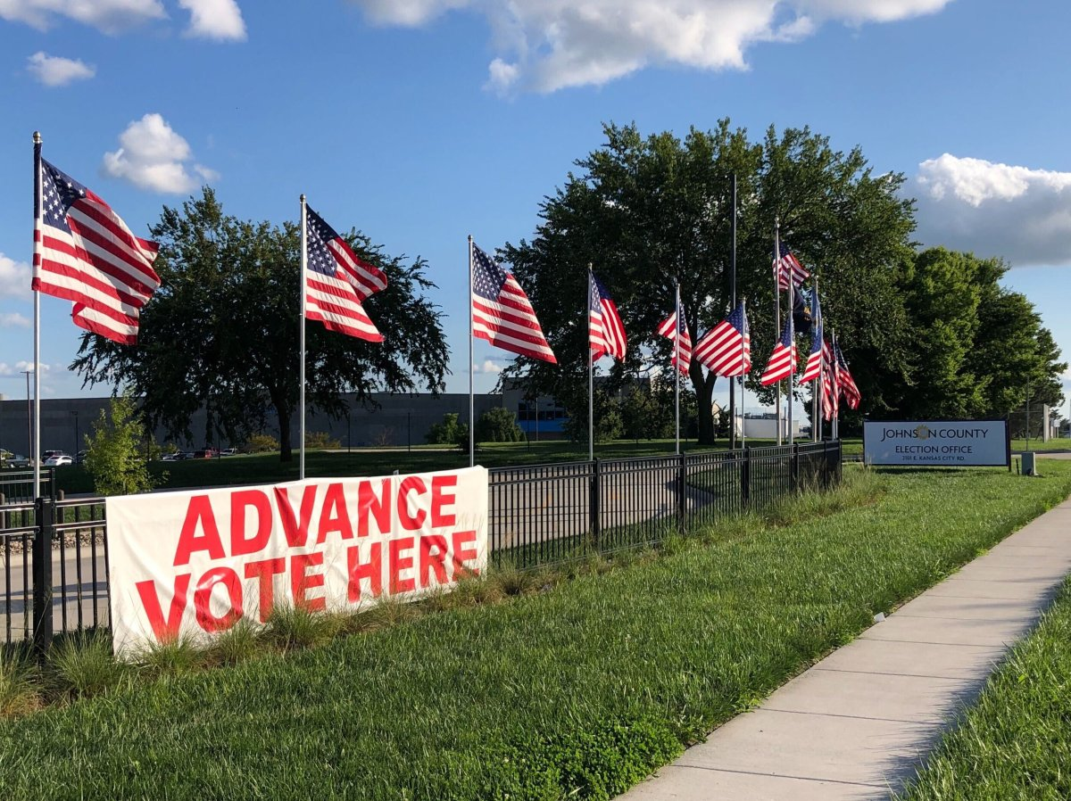 """A sign on a fence in Kansas reads """"Advance Vote Here."""" All Kansan voters are eligible to vote by mail; the last day to request a mailed ballot is Oct. 21. (Kelsey Ryan/The Beacon)"""