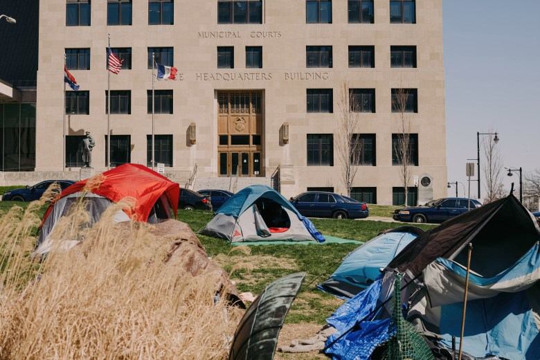 Tents are set up on the front lawn of City Hall, with the headquarters of the Kansas City Police Department nearby. The camp has been occupied by the Kansas City Homeless Union since the end of January.
