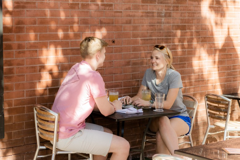 Dalton Toelkes and Emily McEntire have a drink on the outdoor patio at Beer Kitchen.