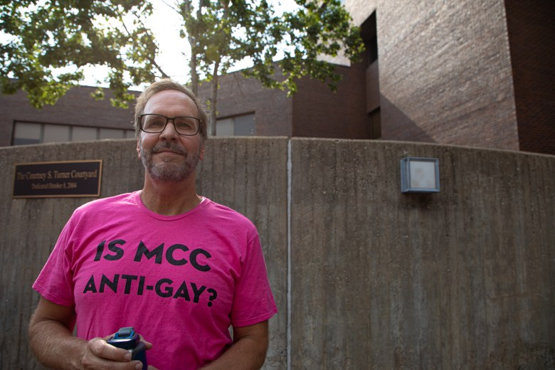 Daniel Wright, a professor of speech and theatre at Metropolitan Community College - Maplewood, attends the June 24, 2021, LGBTQ rally at MCC - Penn Valley to protest a proposed relationship policy.
