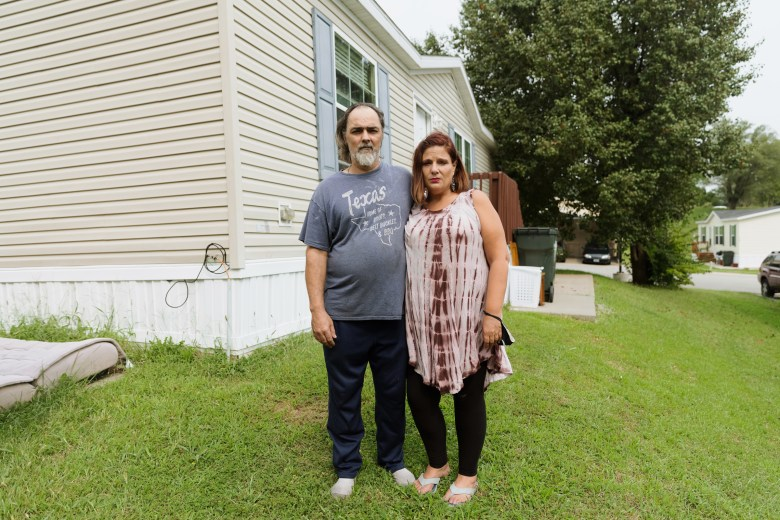 Joseph and Angela Alvelo in front of the home they rent at Lakeview Terrace, a mobile home park in Kansas City, MO.