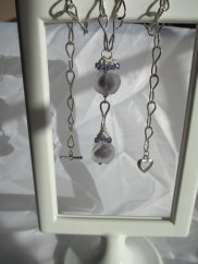 2 etched lampwork beads on silver plated wire with Swarovski bicones