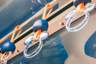 Image of a grab handle on the Disney Resort line monorail, in a Nemo and Friends Searider theme