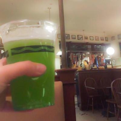 Pictured: Seasonal Halloween Green Beer Cocktail at New York Deli