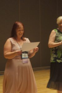 Photo of Elizabeth King winning the Grand Prize for the Royal Ascot writing contest with her manuscript TAMING THE EARL.