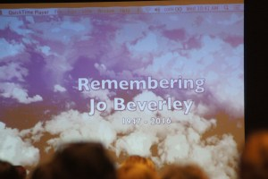 "A photo of the Jo Bevereley tribute at the 2016 Beau Monde mini-conference. The screen reads, ""Remembering Jo Beverley (1947-2016)."""