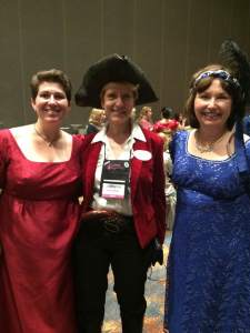 Photo of Alanna Lucas, Alina K. Field and Ann Cleeland, dressed as a highwayman.