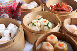 A variety of dim sum in bamboo steam containers