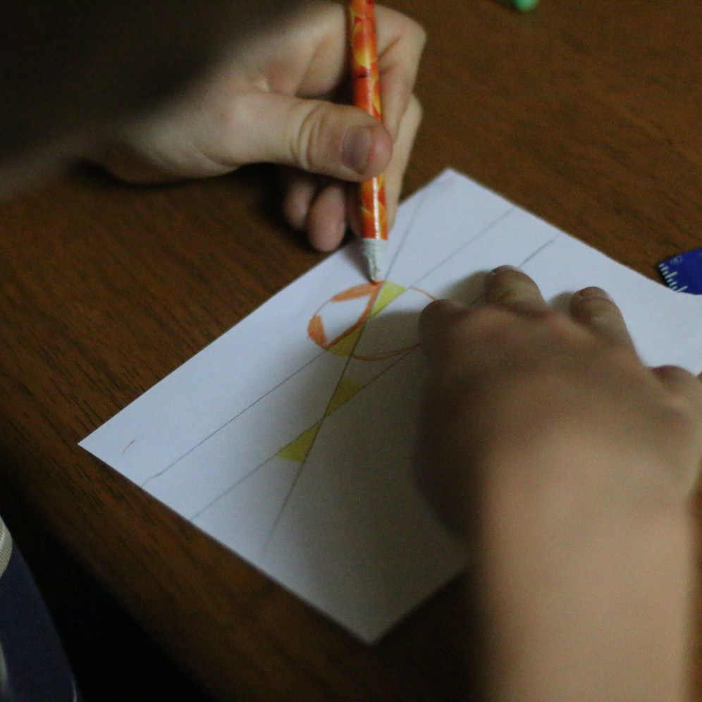 drawing a set of parallel lines and a line that transverses them