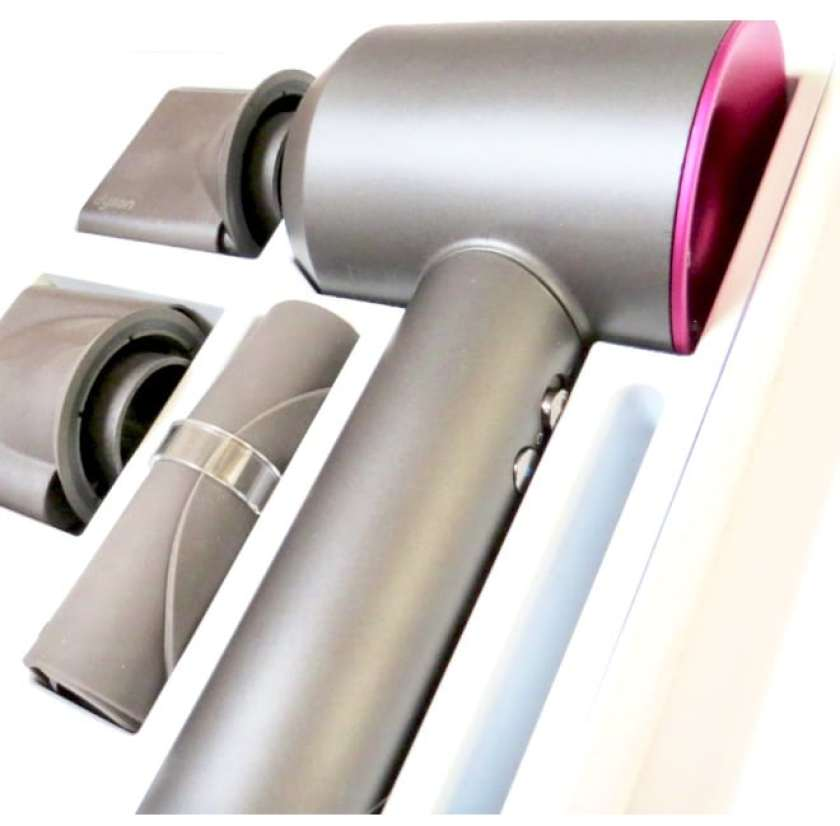 image shows the boxed dyson hairdryer with accessories
