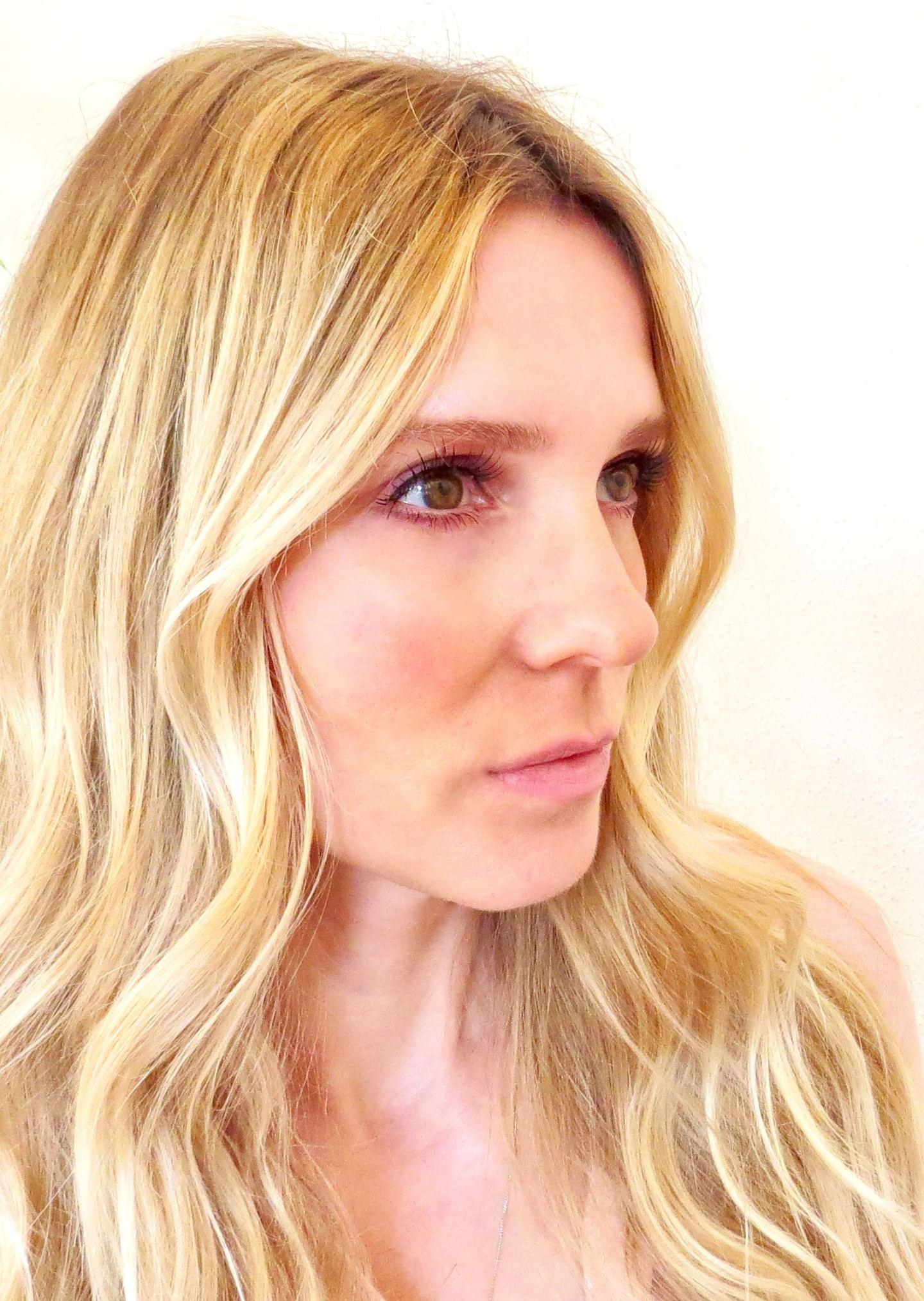 Samantha wearing a pair of threads faux Charleston lashes.