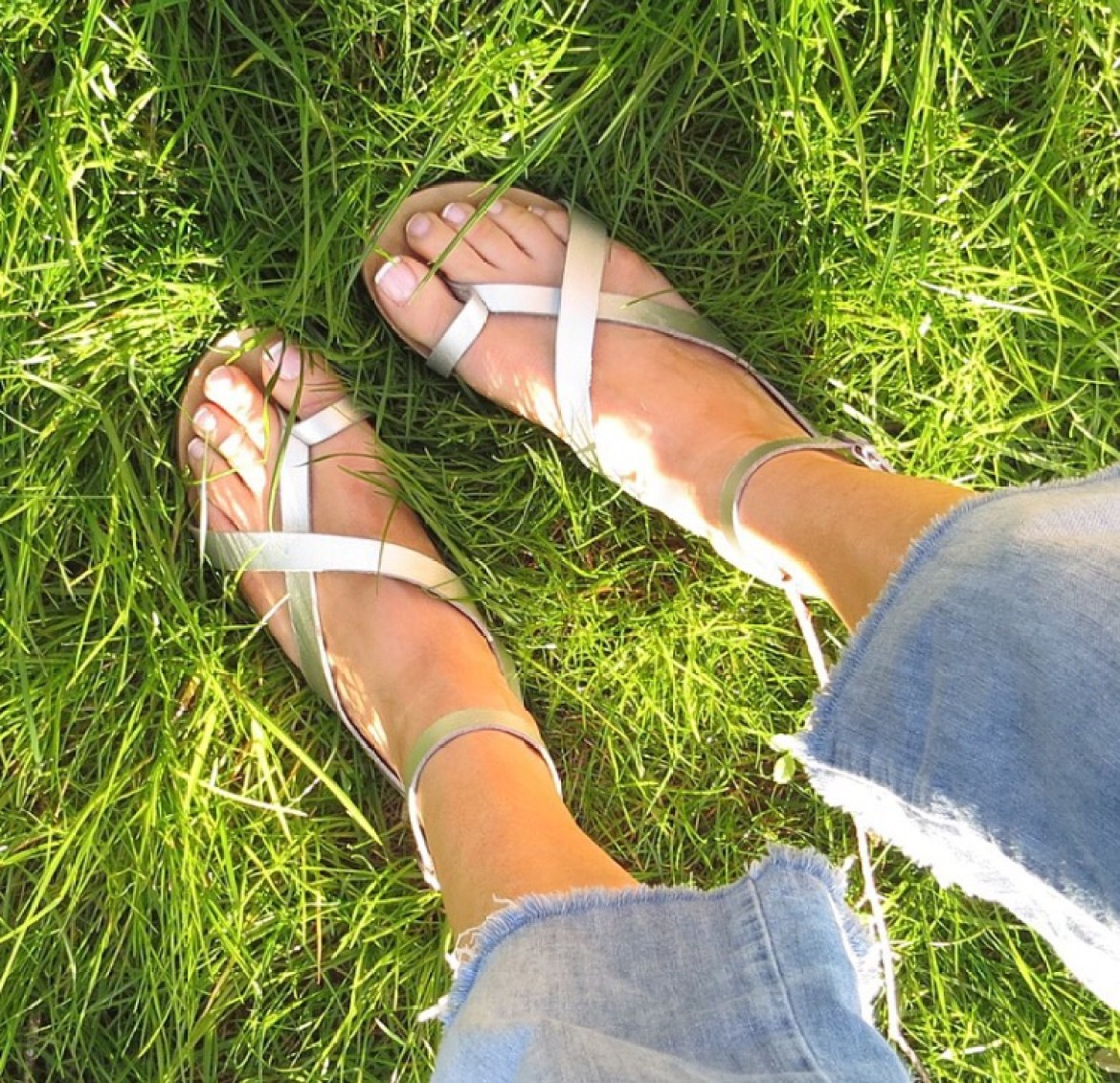 Standing in the grass with sandals on