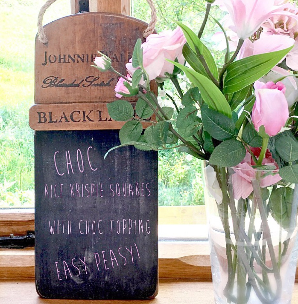 A chalk board with Chocolate Rice Krispie cakes written on it as in a menu
