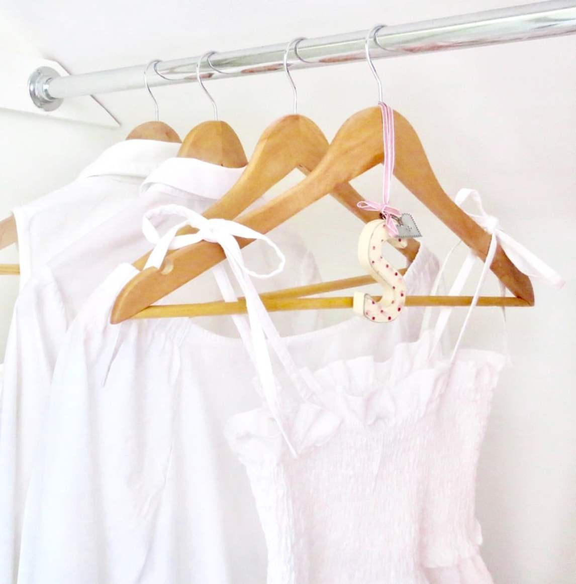 Image shows my favourite white clothing hanging in my wardrobe