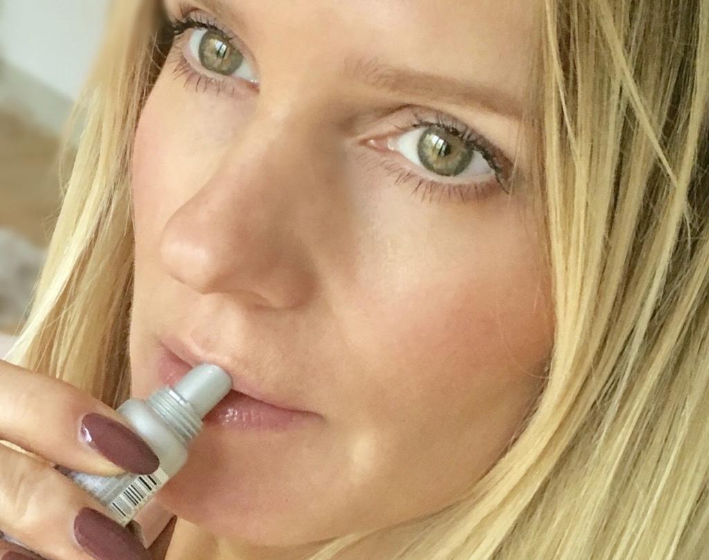 Samantha showing the lip balm shade