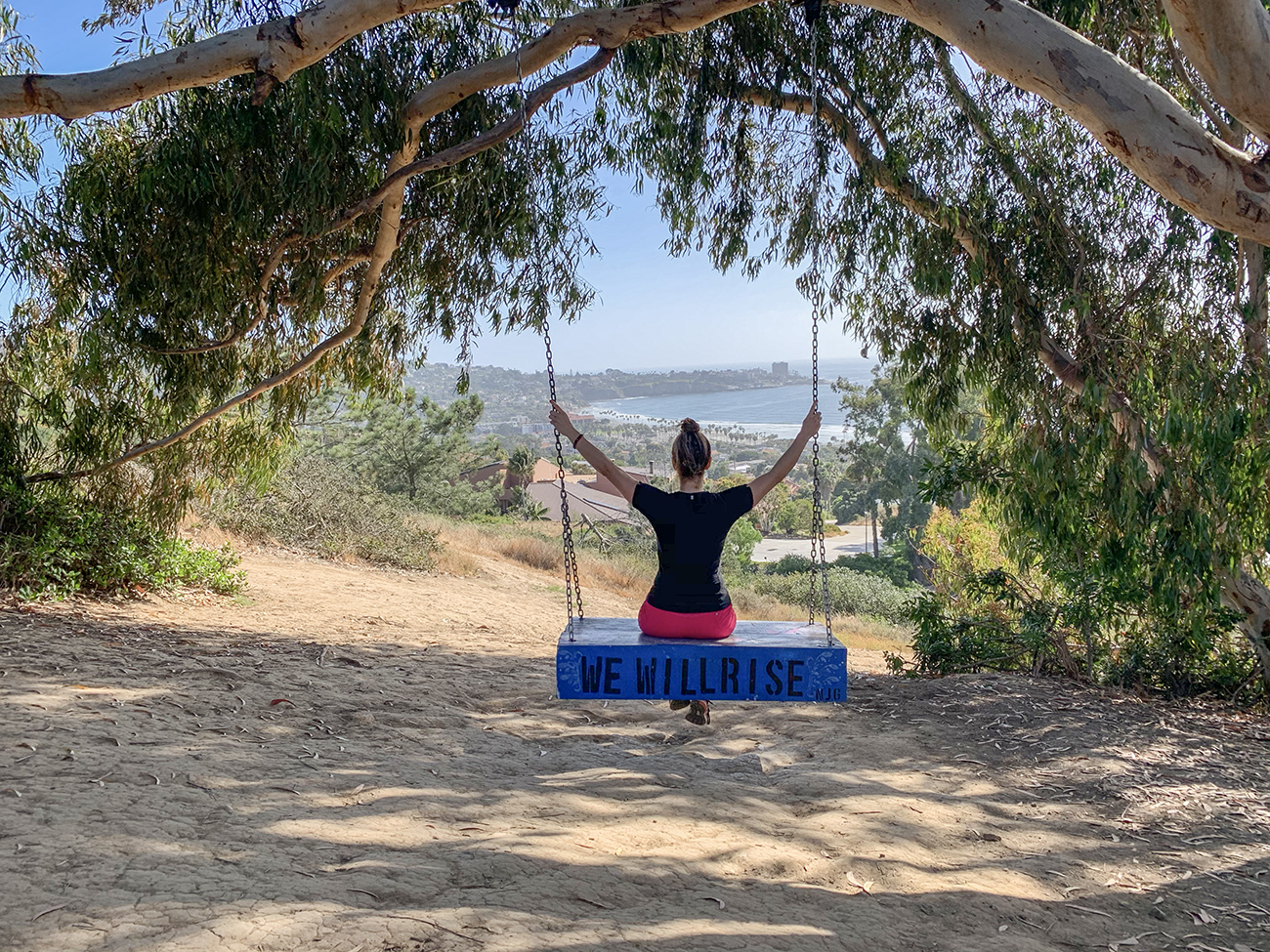 woman sitting on a swing admiring the view