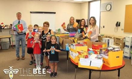 Team Golden Donates School Supplies