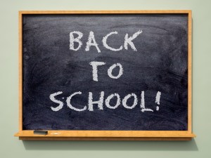'Back to School' written on a school blackboard