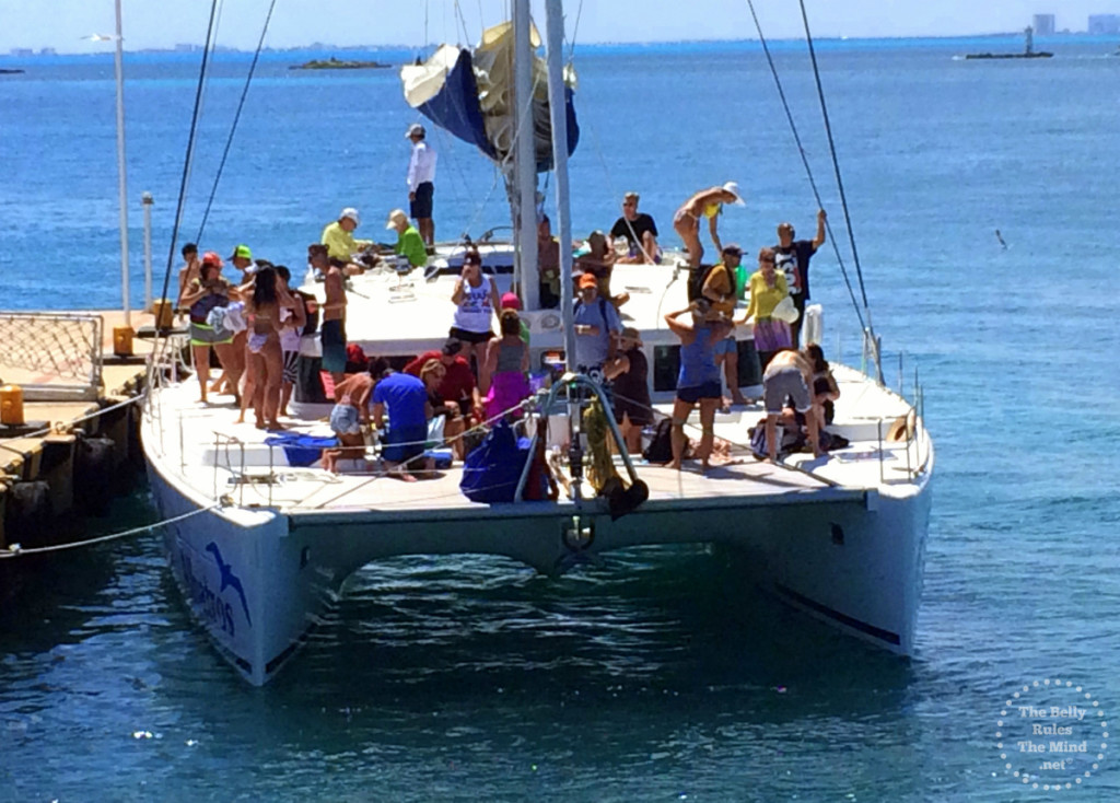 Tourists enjoying the open catamaran , Isla Mujeres