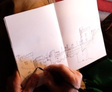 Michael drawing the castle. He filled the sky with cloud dragons...