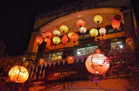 Lit lanterns in one of the shophouses