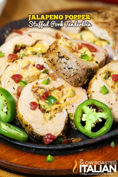 Perfectly seasoned cream cheese, Colby Jack cheese, bacon crumbles and jalapenos create the perfect filling for this Jalapeno Popper Stuffed Pork Tenderloin. A really simple recipe, it comes together in a snap. The end result is a tender, juicy pork tenderloin that is bursting with flavor and will surely knock your socks off!