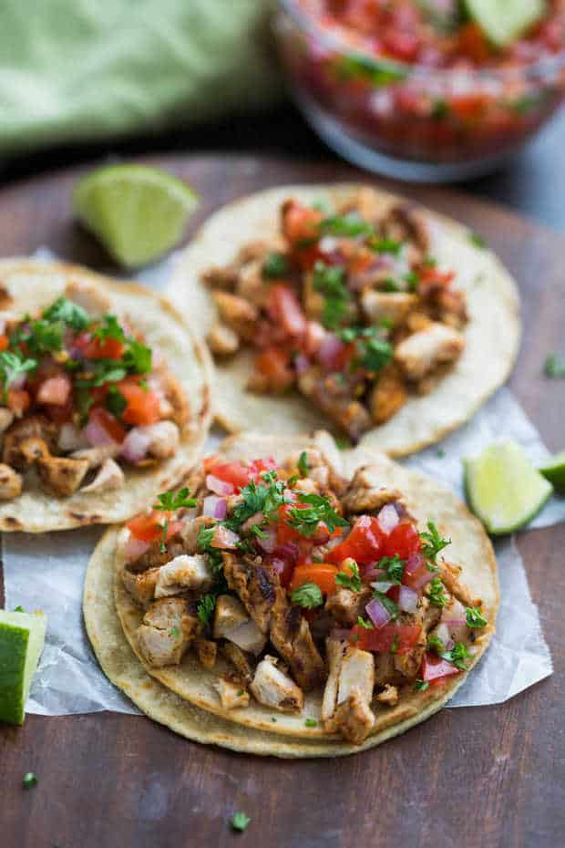 My family goes crazy for these grilled chicken street tacos, and I love how EASY they are to make! Marinated chicken thighs are grilled to perfection and served with warmed corn tortillas, pico de gallo, and cilantro.