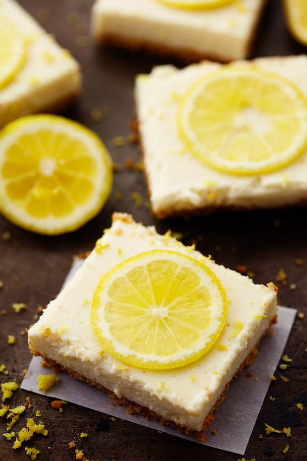 Delicious and creamy lemon cheesecake top a graham cracker crust and chills in the fridge. They are made with lightened up ingredients and make the perfect lemon dessert!