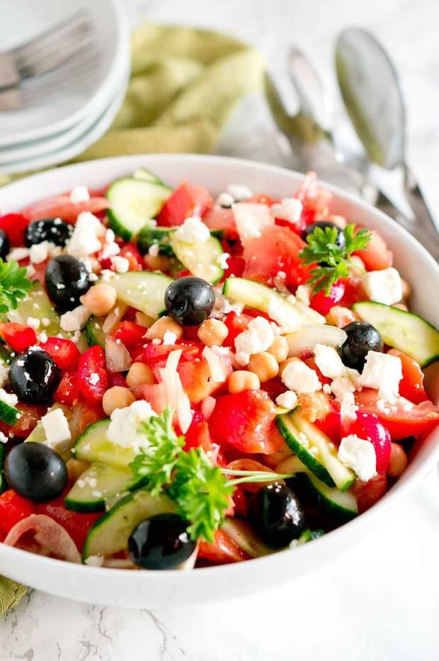 Greek salad is brimming with flavor – loaded with delicious fresh vegetables, olives, chickpeas, and feta cheese tossed in a light and refreshing greek salad dressing.