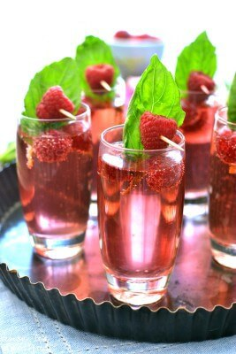 These Raspberry Basil Champagne Spritzers are gorgeous and perfect as a summer cocktail. Blush champagne combined with the delicious flavors of raspberry and basil. Sweet and refreshing! | Featured on The Best Blog Recipes