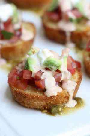 Love Mexican inspired recipes? Then you'll love these Sweet Corn Tamale Cakes! They're a copycat version of the yummy appetizer from The Cheesecake Factory.   Featured on The Best Blog Recipes