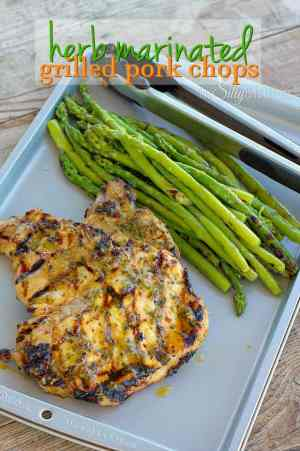 You will love these Herb Marinated Grilled Pork Chops! They're easy to put together and have a lot of flavor that the whole family will love!!