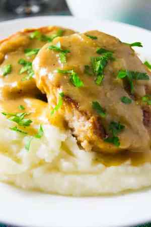 Smothered Slow Cooker Pork || Featured on www.thebestblogrecipes.com