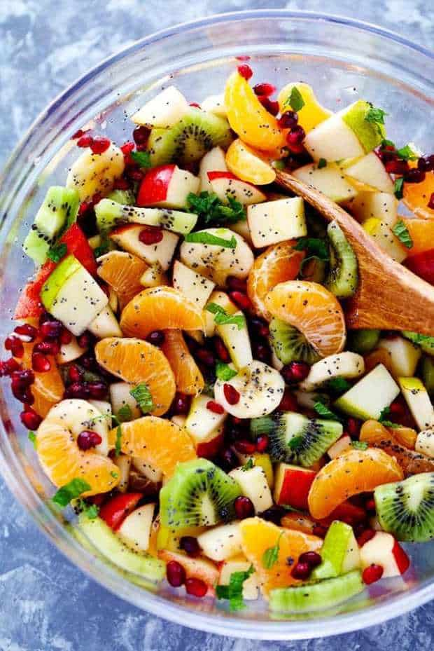 he Best Winter Fruit Salad is filled with clementines, kiwi, pears, apples, and pomegranate. It gets tossed in a delicious honey lime poppy seed dressing and you won't be able to get enough!