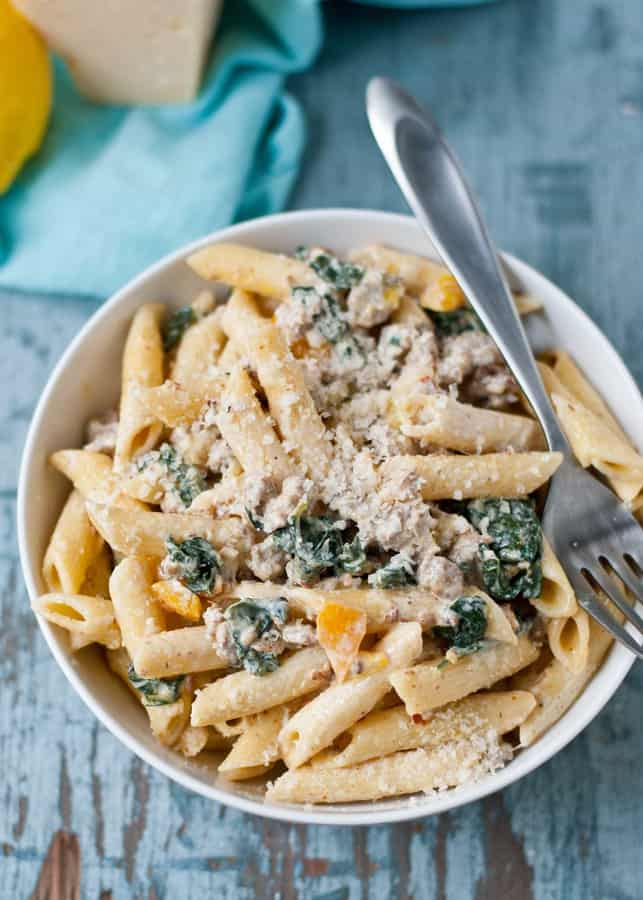 This Creamy Parmesan Sausage and Kale Pasta is a comforting meal that comes together in less than 30 minutes.
