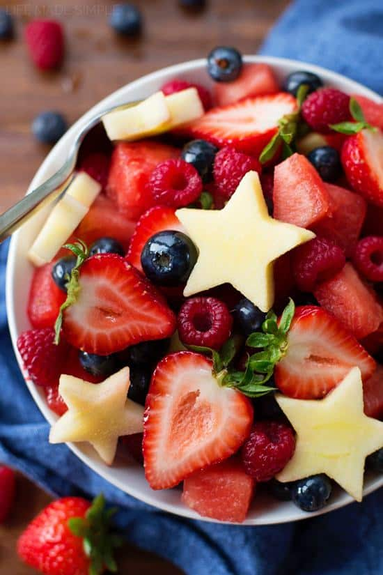 This red, white and blue fruit salad is perfect for summer picnics and celebrations! It's a festive and fresh combination of fruit drizzled with a touch of honey citrus dressing.
