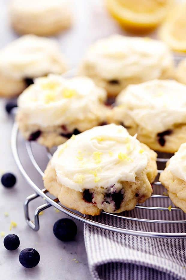 Soft, cake like cookies that are bursting with fresh blueberries and have a hint of lemon. These cookies melt in your mouth and are topped with the most amazing lemon cream cheese frosting!