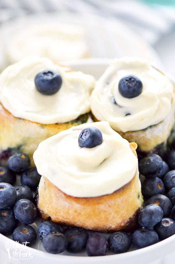 These Gluten Free Blueberry Sweet Rolls are perfect for Spring brunch. They're easy to make and come together quickly! Don't skip the cream cheese icing!
